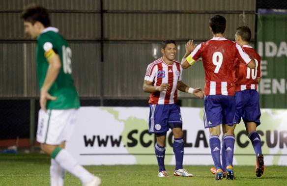 Paraguay's Richard Ortiz celebrates with teammates after scoring against Bolivia in their 2014 World Cup qualifying soccer match in Asuncion
